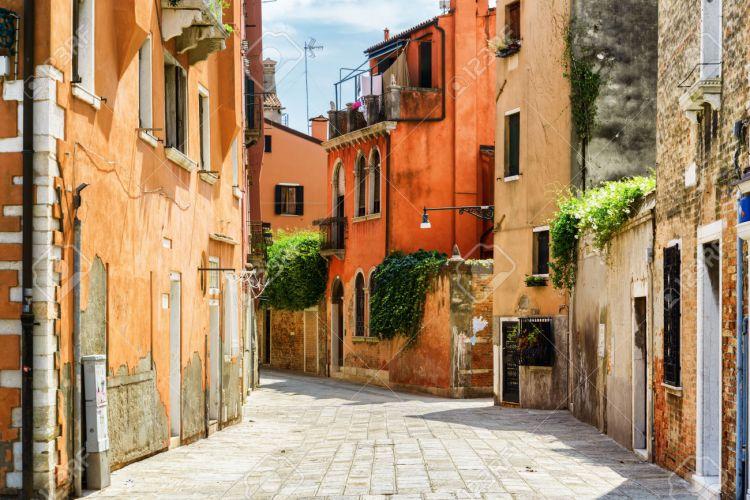 Facades of old houses on Calle Gradisca Cannaregio. Venice